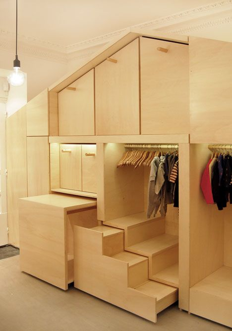 children's closet wall that doubles as a playhouse -  Mut Architecture and Benjamin Mahon