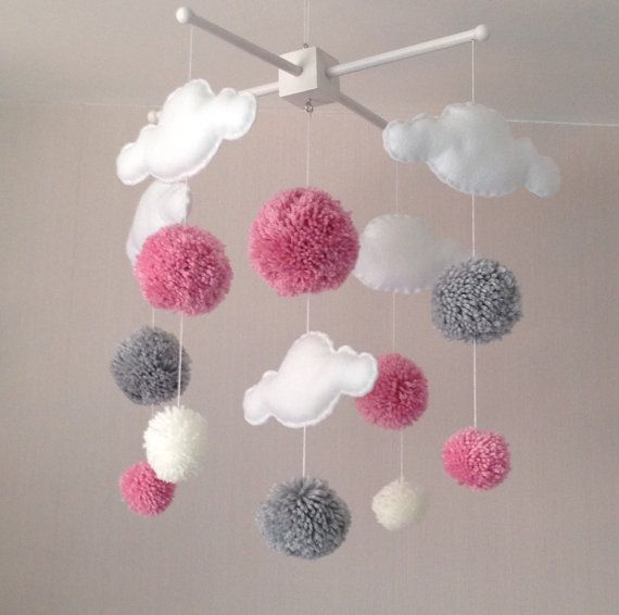 Clouds and Pom poms baby cot mobile. An ideal gift for a new babys nursery or for room decor in an older childs bedroom.  This mobile consists of five