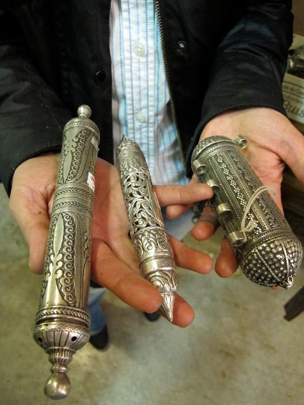 antique cylinders used to deliver rolled up handwritten letters.