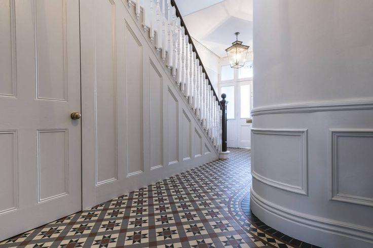 Full renovation on Trinity Road, London : Modern corridor, hallway & stairs by Grand Design London Ltd
