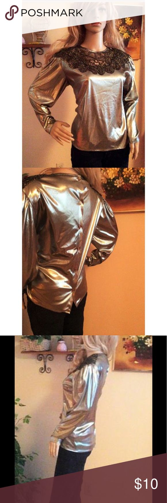 """Petite Sophisticate Metallic Vintage 80's Blouse This silver metallic blouse is sure to make a statement!  This vintage 1980's blouse is made of a soft foil fabric; it also has long sleeves, and buttons in the back. The neckline is made of black and gold knit material.  The size is 4; the measurements (lying flat) are: Length: 21.5"""" Bust: 20""""  The blouse has light shoulder padding, and is made of 100% polyester; the material stretches.  Used; Excellent Condition Petite Sophisticate Tops…"""