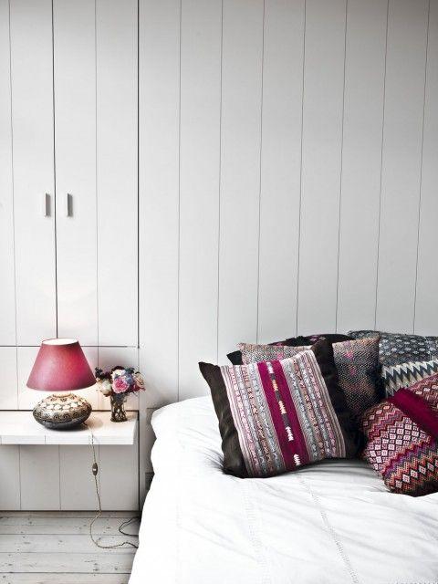 richly coloured cushions in monochrome bedroom in Belgian house designed by Vincent van Duysen, photo Karel Balas via Remodelista