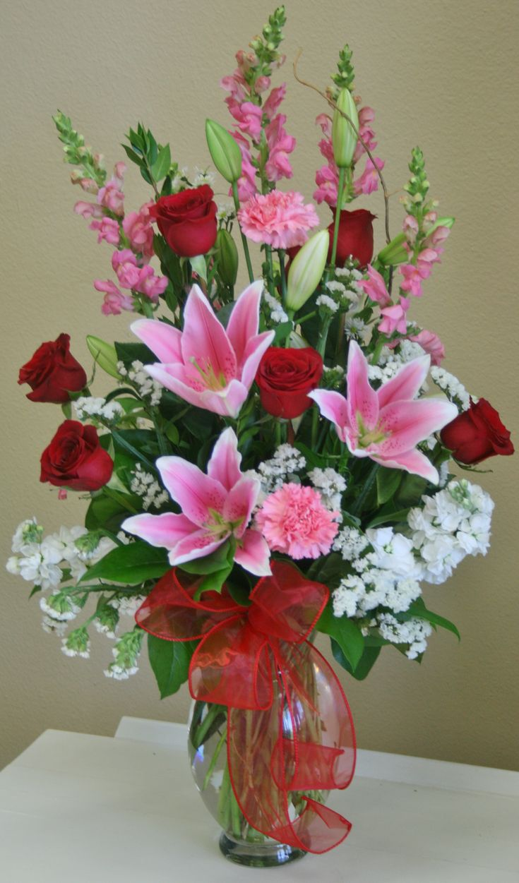 A romantic red, white and pink flower arrangement by your local Riverside florist - Willow Branch Florist of Riverside