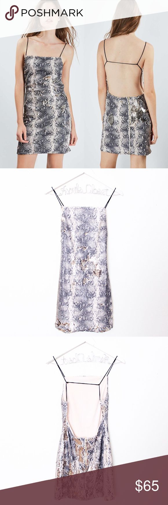 """Metallic Snakeskin Sequin Backless Dress Topshop ⑊ no size tag (fits like a size 4 — check measurements) ⑊ MSRP $125.00  ⌁ Measurements: 30"""" length 29"""" bust 25.5"""" waist  ⌁ Material: no material tag  ⌁ Condition: Used once. No visible wear. Still in great condition!  Comment below if you have any questions. Please make all offers using the """"offer"""" button. No trades. No holds. Comes from a smoke-free/pet-free home. Not responsible for lost/damaged mail. All sales are final. ♡ Topshop Dresses…"""
