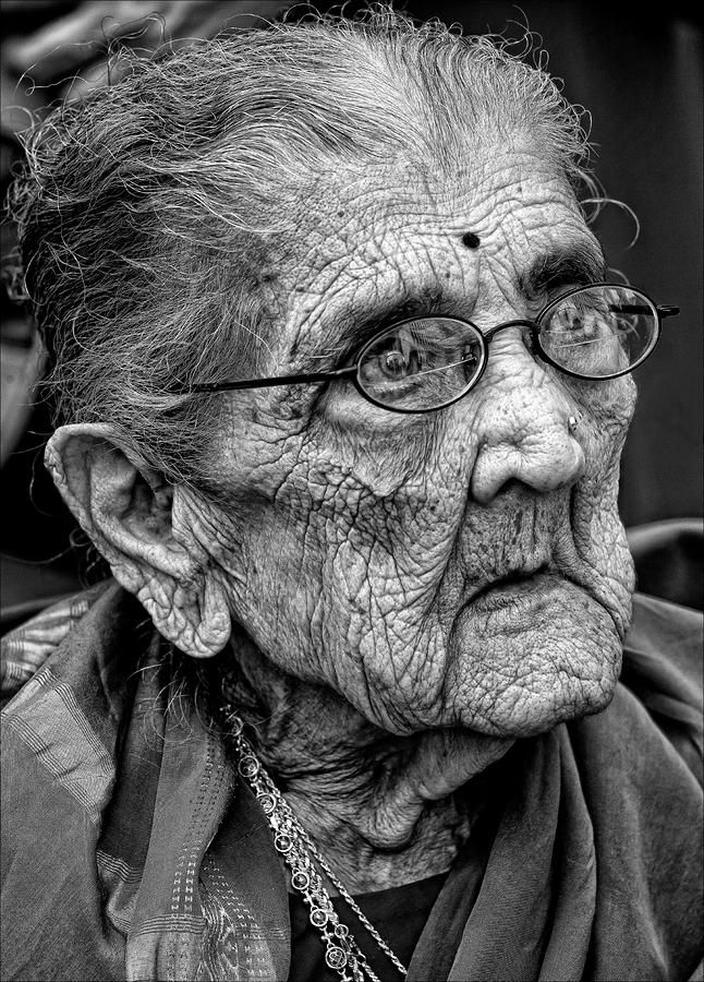 Old lady, glasses, powerful face, intense, strong, lines of life, wrinckles, aged, beauty, wisdom, cracks in time, portrait, photo b/w.