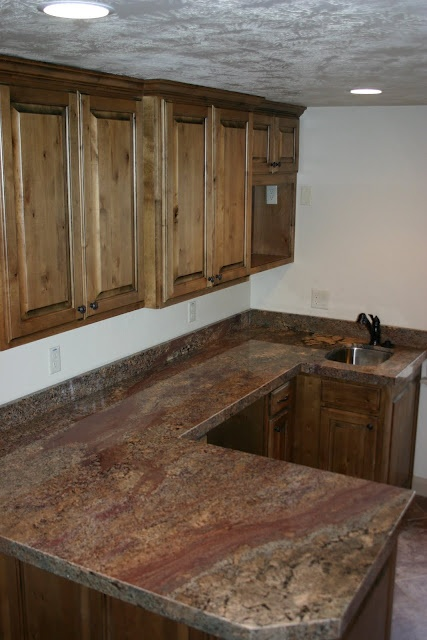 Crema Bordeaux Granite Countertops In A Basement Kitchen.