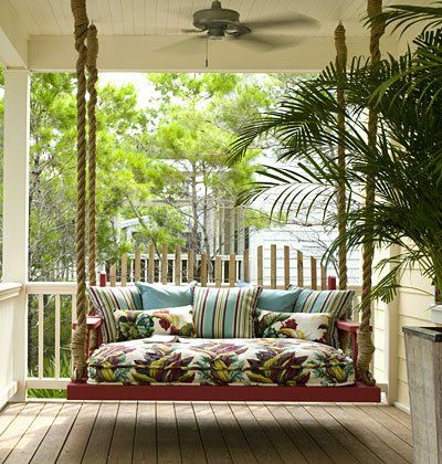 Look at this plush and tropical porch swing pictured on Flickr. I love the chunky ropes attaching it to the ceiling!  - http://www.knottinghillinteriors.com/