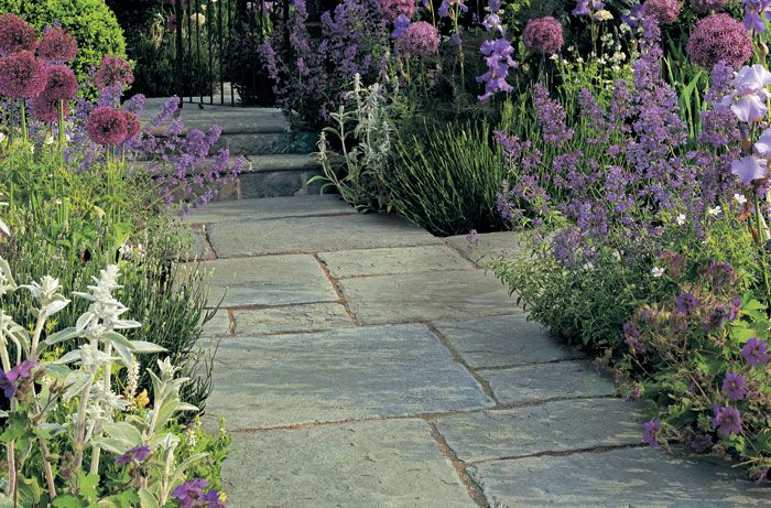 Stonemarket Millstone concrete paving slabs from AWBS Landscaping and Building Supplies. #pavingslabs #patioslabs #concretepaving