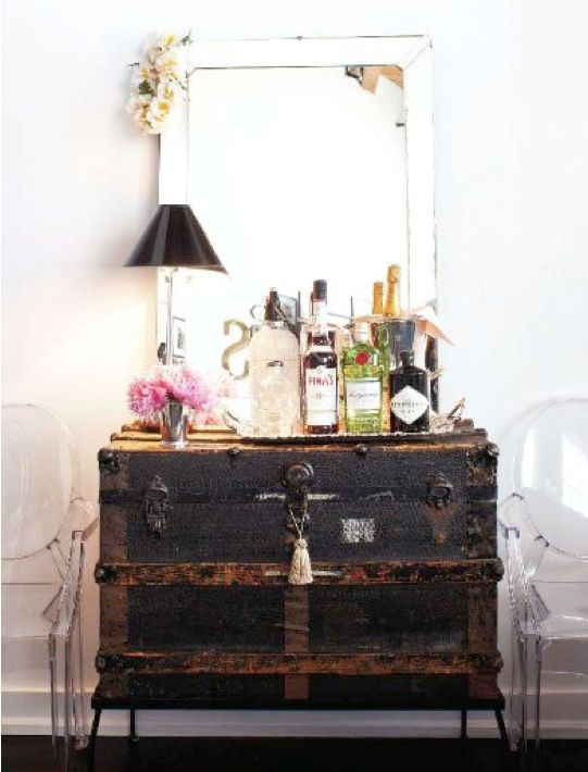 vintage trunk vanity // trunk dresser, large mirror, lucite chairs, ghost chairs, bar cart, liquor, old trunk, tassel