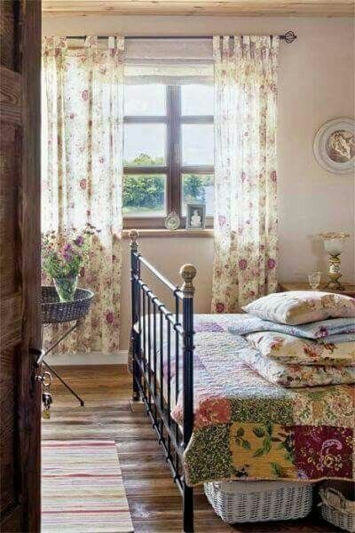Country Bedroom with Bohemian vibe pulled from the greenery and light air feel. Pops of bright color from the quilt on the bed