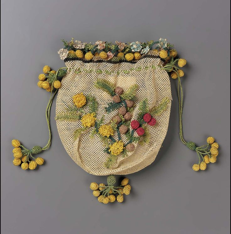 Drawstring bag, cream netted ground, berries and flowers in biblia work, yellow ball tassels.