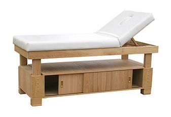 Deluxe Storage wooden Treatment bed. Available in dark wood finish, natural wood, black satin and white gloss.