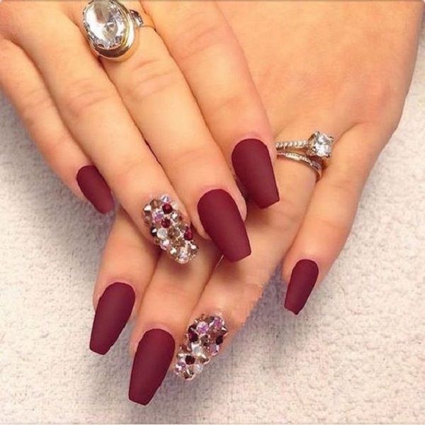 Wonderful matte maroon nail art design. The maroon polish is them combined with amazing looking silver, gold and red embellishments arranged on top, making the design look even more elegant.