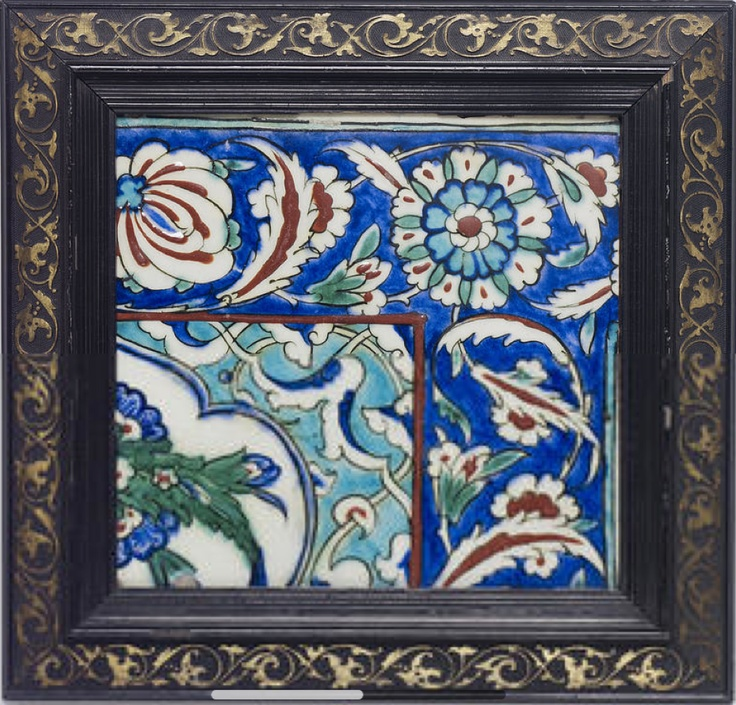 An Iznik pottery corner Tile  Turkey, circa 1580  of square form, decorated in polychrome underglaze blue, raised red, turquoise, green and black outline with meandering saz leaves and floral heads on a blue ground, one corner with a part cartouche bearing a floral motif on a reserve of turquoise arabesque, framed   35.cm x 34.4 cm. (with frame)