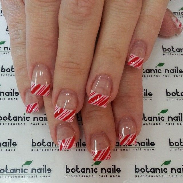 Candy cane French tip nails.