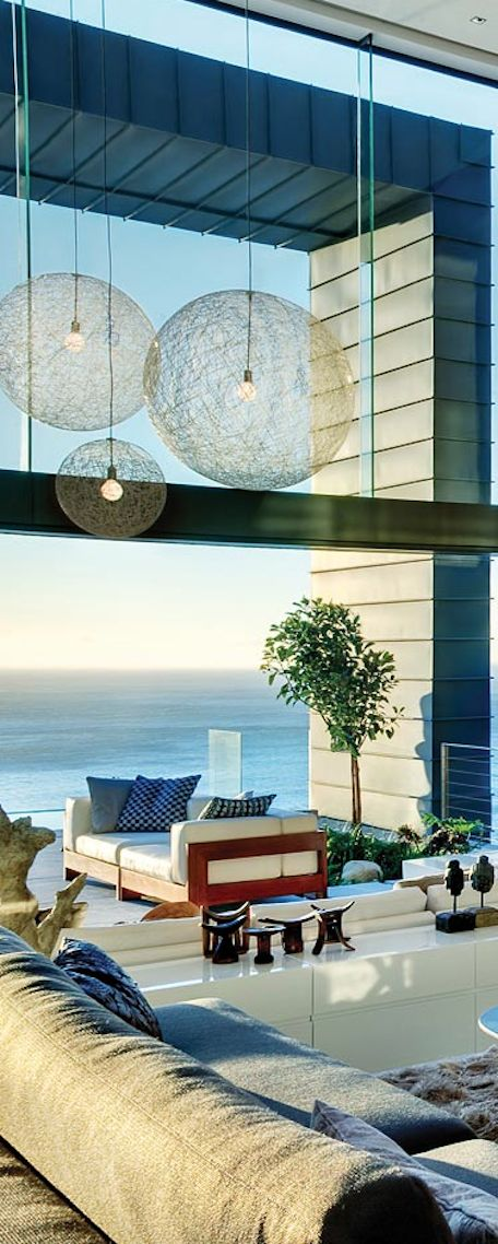 A modern home overlooking Clifton, in Cape Town South Africa. This home is absolutely breathtaking with views of the Atlantic Ocean and Lions Head.