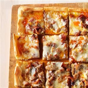 Brat & Bacon Appetizer Pizza Recipe -Brats and bacon on pizza are a fine beginning, but I jazz them up with apricot preserves and honey mustard. These cheesy bites please my toughest critics. —Colleen Vrooman, Waukesha, WI