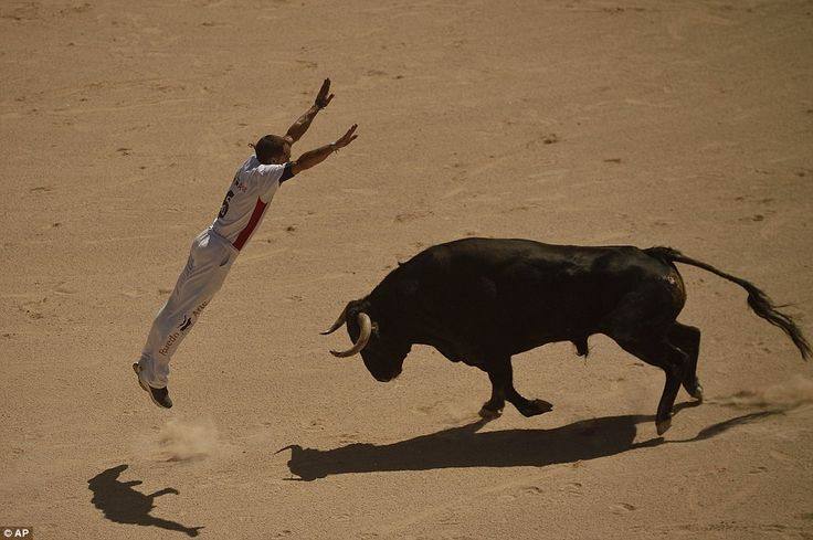 Incredible images shows 'Recortador' JUMPING over a charging bull