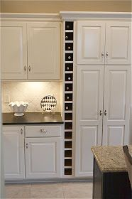 Wine rack~ Great idea for narrow spaces!