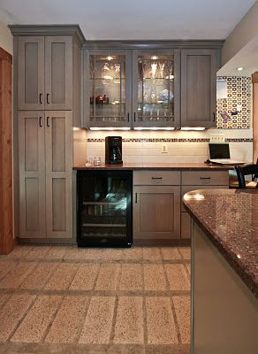 grey cabinets...black appliances to cut down on finger prints with stainless steel