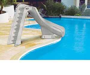 The Typhoon Slide stands a dwarfing 7 feet 4 inches tall to the top of the handrails. A formidable slide for the backyard pool. http://www.intheswim.com/Pool-Accessories/Pool-Slides-for-In-Ground-Pools/Typhoon-Pool-Slide/#