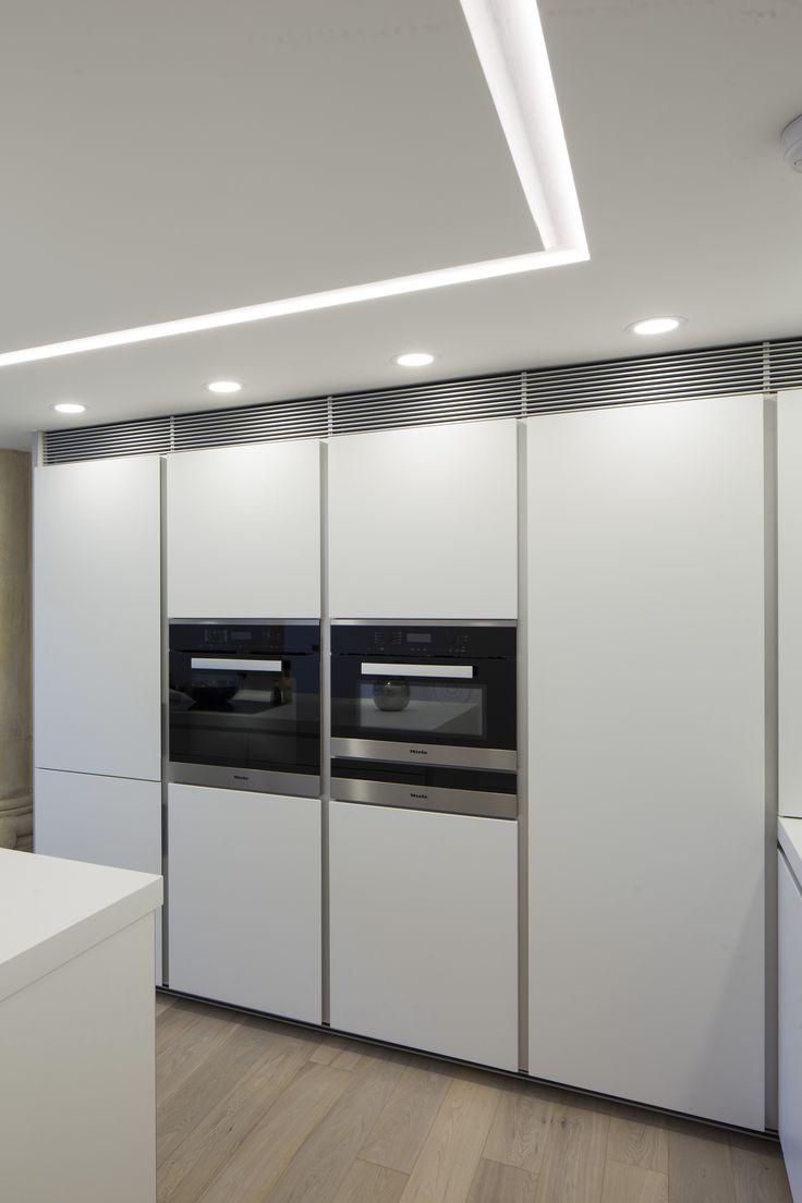 bulthaup b1 kitchen in Alpine White matt lacquer. Miele and Elica appliances.