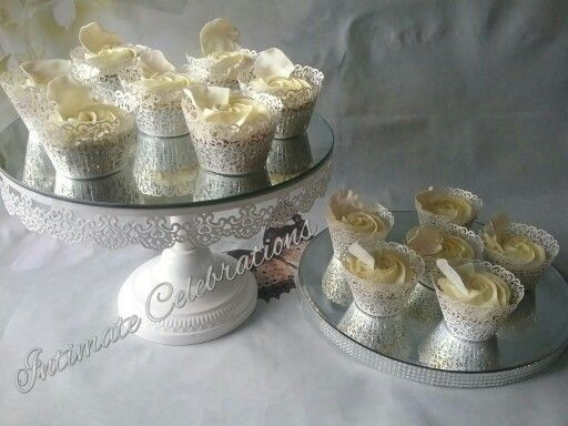 Simply eligant butter cupcakes with white chocolate GANACHE and fondant rose petals