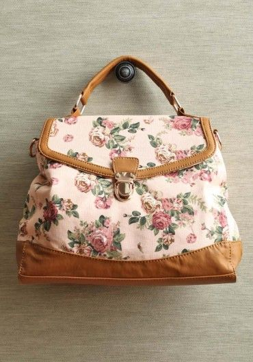 loving feeling floral bag  $44.99  A delicate rose print adds modern romance to this peach canvas purse accented with tan leatherette details, gold colored hardware, and a spacious interior pocket with a zipper closure. Optional shoulder strap.