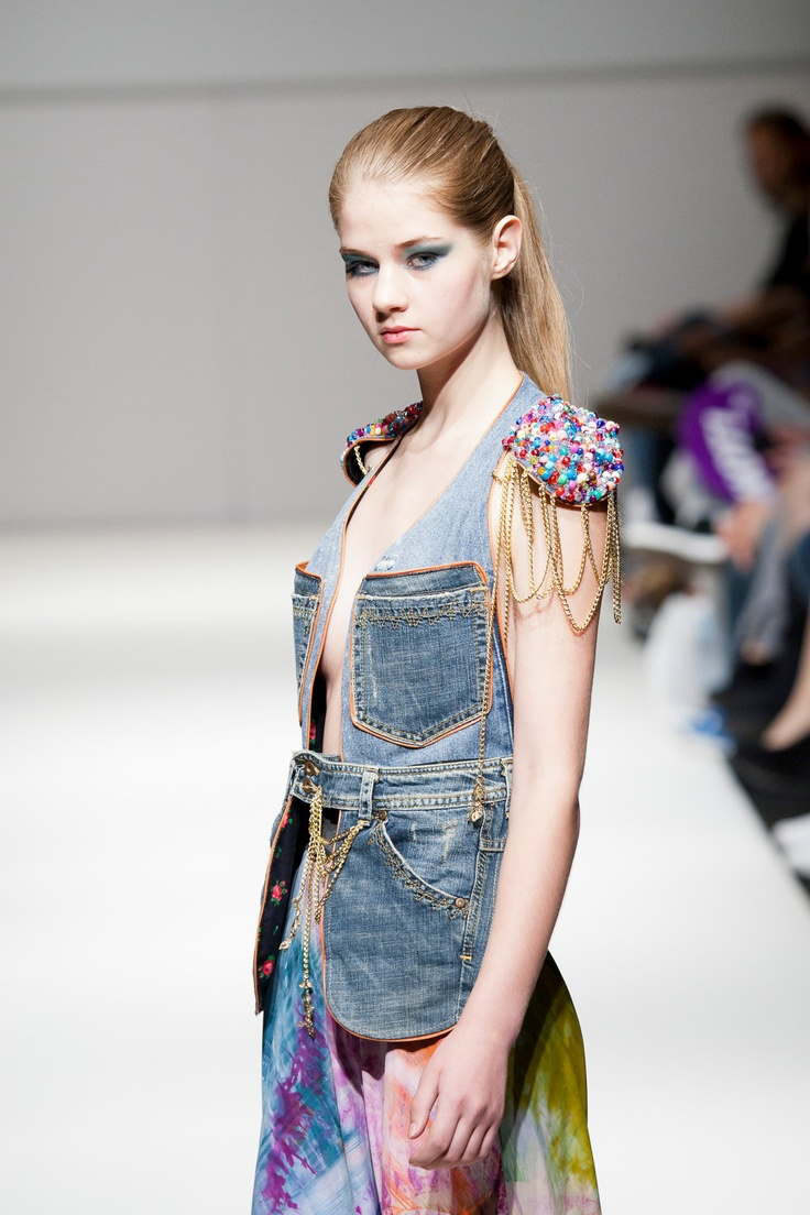 MRJ's Candy Girl Bag: featured on the Vienna Fashion Week runway, can be worn as a vest but used as a bag, vintage blue denim, lined with classic black floral cotton fabric, colorful beaded application on both shoulders, chains, finished with a denim flower on the center back, six spacious pockets, buttons up in the front