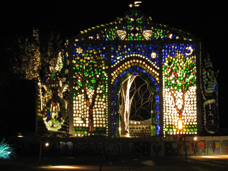 This is the Bottle House at Airlie Gardens in Wilmington, North Carolina. The Bottle House is made entirely of glass bottles stacked with the bottom facing outward and set by mortar.
