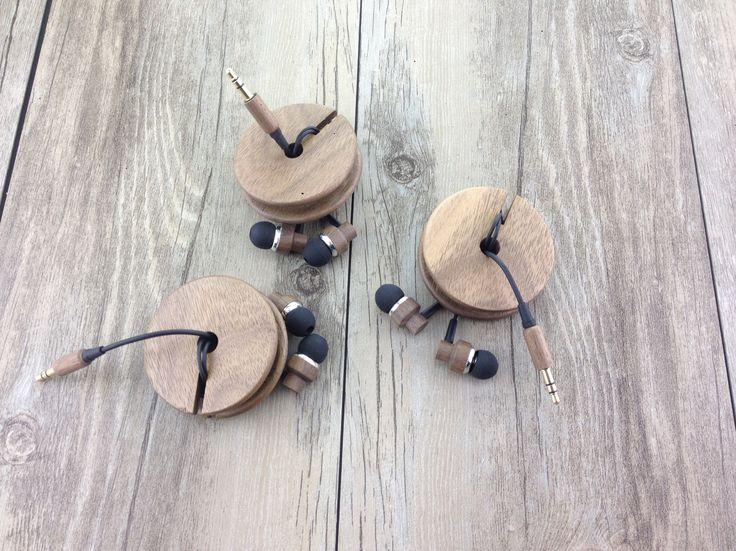 Wooden earphones with wooden case.