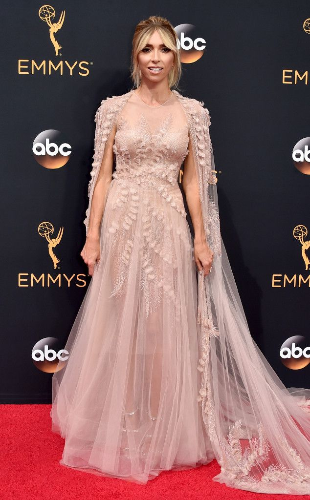 2016 Emmys: Giuliana Rancic is wearing a blush Georges Chakra Couture with a long cape. Giuliana is gorgeous from head to toe! The cape makes the outfit! The dress is ethereal and feminine.