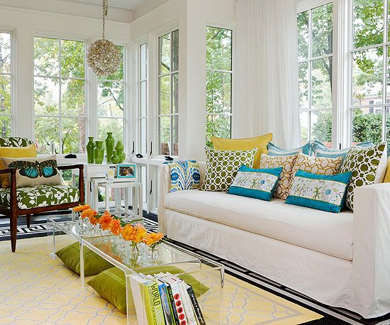 Easily update any space with patterned pillows, throws or rugs. More sunroom decorating: http://www.bhg.com/home-improvement/porch/sunroom-decorating-and-design-ideas/?socsrc=bhgpin070513=9