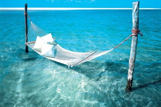 Sandy beaches stretch along the shore like ribbons of fresh powder leading you to sparkling waters.  Sink into a hammock surrounded by tropical paradise in Mozambique's archipelagos.