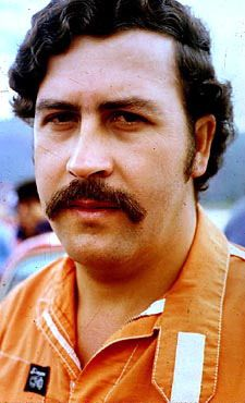 Colombia. Drug czar. Leader of the Medellin Cartel, he was killed in a rooftop of the safehouse where he was hiding in Medellin. At his height in the 1980s, he owned fleets of boats and planes, 19 separate residences in Medellin, each with its own helipad.  Forbes magazines named him one of the 20 richest men in the world, more than once.  He is the only declared public enemy Colombia has had in its history.