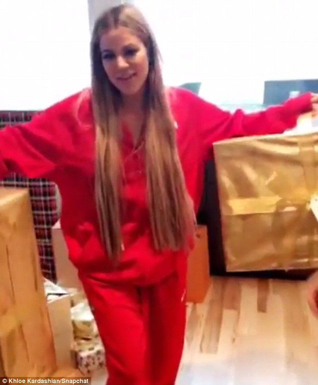 'Hi Santa!' Khloé Kardashian jetted from California into Ohio Saturday night to spend Christmas morning with her boyfriend of five months Tristan Thompson at his Cleveland home