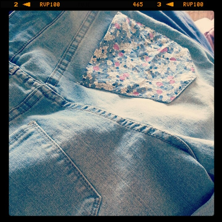 Upcycled denim shorts with floral pocket detail