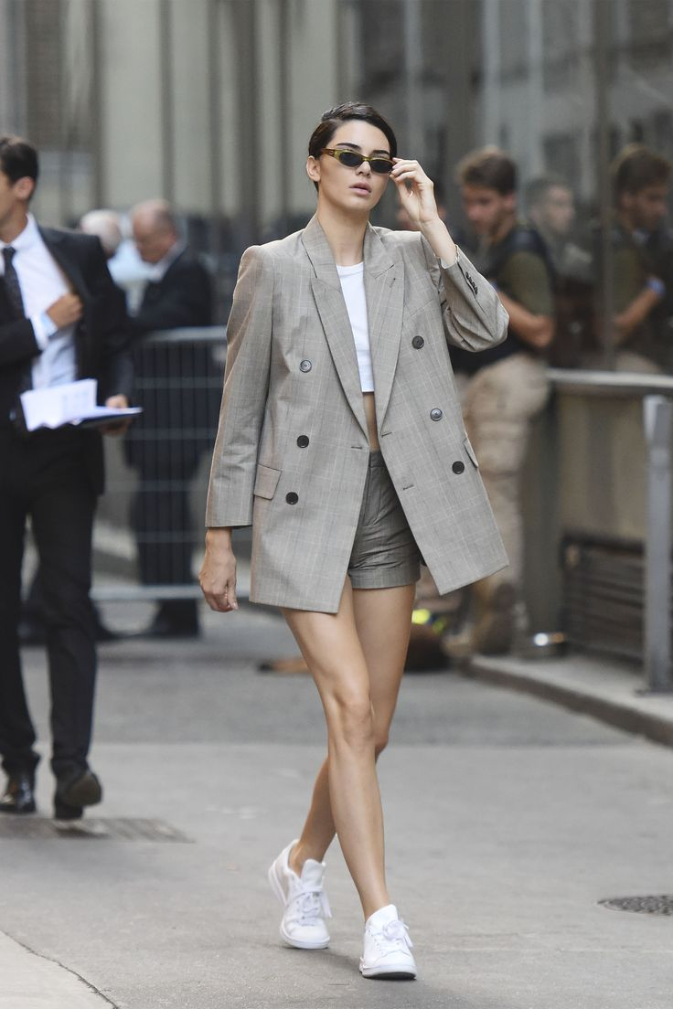 Kendall Jenner makes us believe in the shorts suit by pairing an oversized blazer with high-waisted shorts and Adidas Stan Smith sneakers.