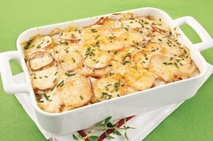California Creamy Potatoes ~ What You Need: *1-1/2 cups  KNUDSEN Sour Cream *1 can  (10-3/4 oz.) condensed cream of potato soup *2 cloves  garlic, mince *2-1/2 lb.  red potatoes (about 8), very thinly sliced *1 cup  shredded CRACKER BARREL Vermont Sharp-White Cheddar Cheese  *2 Tbsp.  chopped fresh chives.