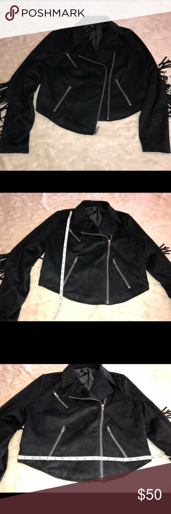 NWOT torrid black faux suede fringe jacket plus 00 NWOT Black faux suede fringe cropped moto jacket from Torrid plus size 00. I lost a lot of weight and by the time the season came to wear it it was too big for me. All items come from smoke free home. 🐺Husky friendly environment. All items are kept in plastic containers, but shed happens 😊 torrid Jackets & Coats