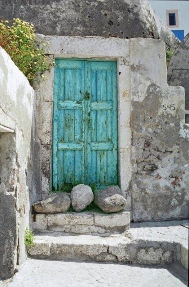 Turquoise door with rocks