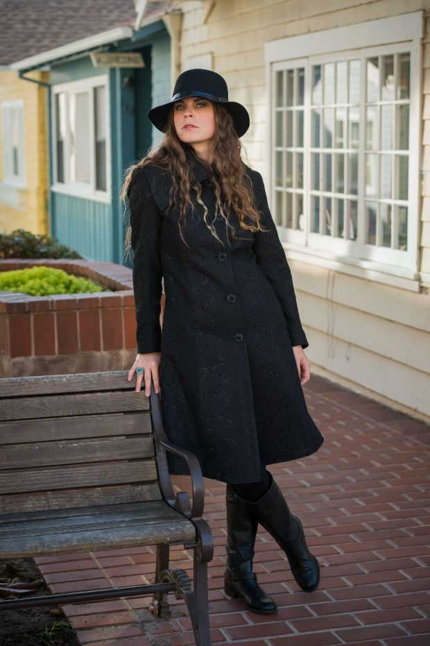 The Black Ashbury hat has perfectly matched itself with the black dress.