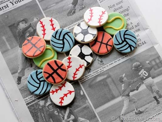 Sport's Cookies Tutorial | Vanilla sandwich cookies are converted into edible basketballs, tennis balls, volleyballs and more with the use of fondant and edible food coloring markers.  These decorated cookies are an adorable garnish for cupcakes or great to bring to a team party.