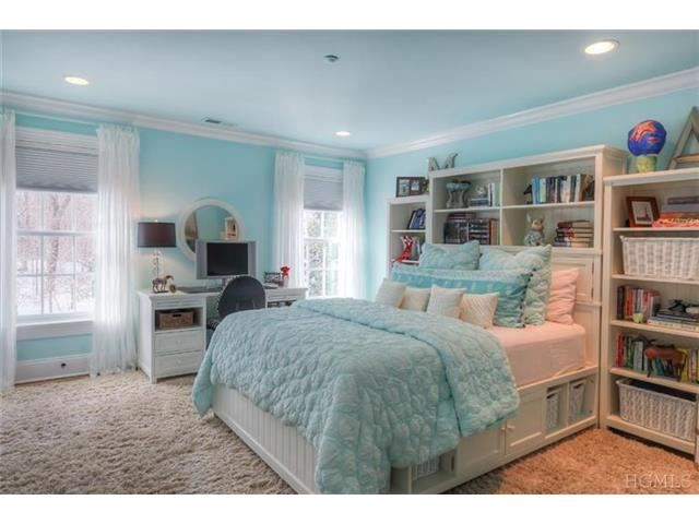 this tiffany blue bedroom is so beautiful with its large
