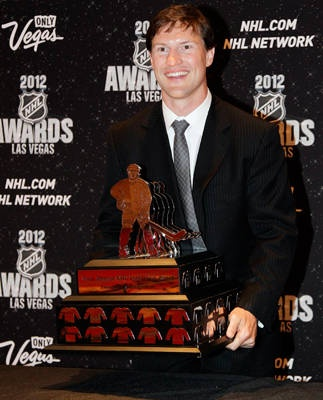 Shane Doan of the Phoenix Coyotes poses with the Mark Messier Leadership Award, which was handed to him from the trophy's namesake.