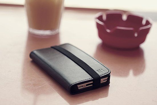 Hex Code Wallet - A genuine leather wallet and iPhone cover in one great item. The Cover is secured by a heavy-duty, old school elastic strap and opens to reveal 3 credit card slots. When closed the cover protects your iPhone and slips easily into a pocket due to its slim profile.
