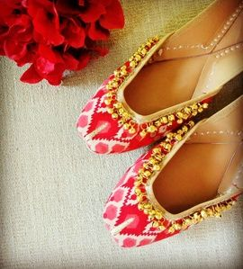 Wedding Shoes - White and Pink Juttis | WedMeGood White, red and pink Ikat Print Juttis with Gold Ghungroos by Vian Label. Find More jutti designs by Vian Label on wedmegood.com #wedmegood #juttis #shoes #ghungroo