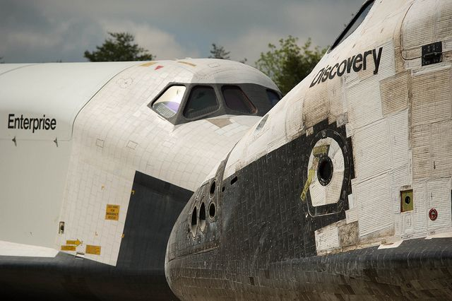 April 19, 2012. Space Shuttles Enterprise, left, and Discovery meet nose-to-nose during the Welcome Discovery ceremony at the Smithsonian's Steven F. Udvar-Hazy Center in Chantilly, VA. Photo credit: (NASA/Carla Cioffi - 201204190028HQ)