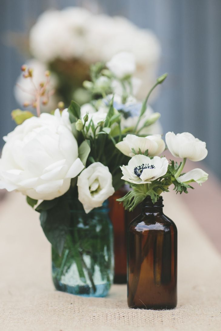 White Flowers in Vintage Medicine Jars | Homecoming | READYLUCK Photography https://www.theknot.com/marketplace/readyluck-772151