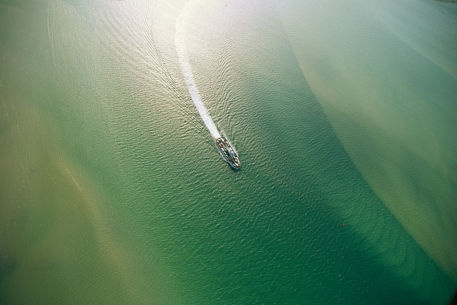 An aerial view of a ferry making the trip to Ocracoke Island. by National Geographic on artflakes.com as poster or art print $16.63